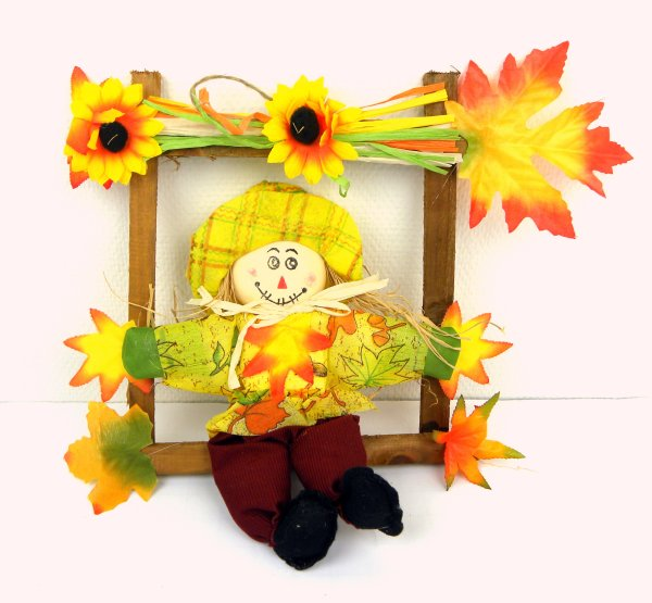 Straw doll in<br>wooden frame