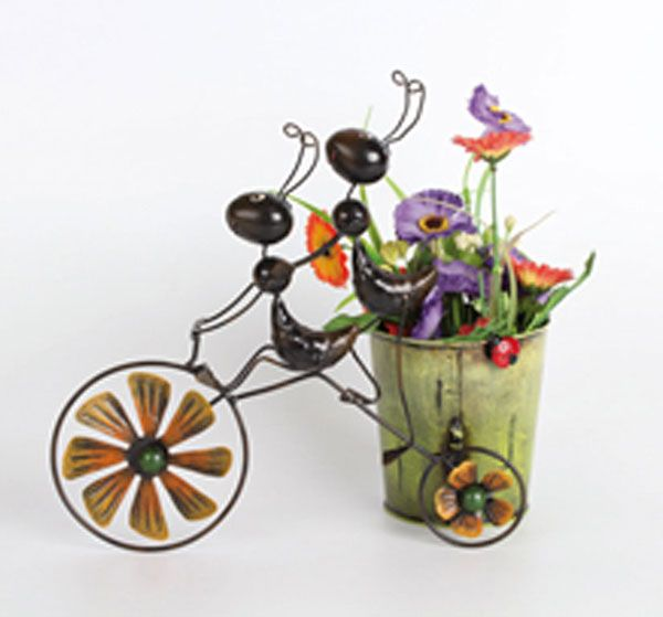 Two ants on a bike<br>with flower pot